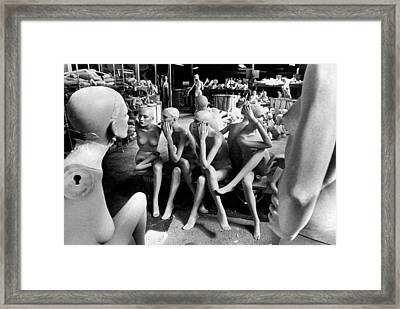Puzzled Mannequins Framed Print by Underwood Archives