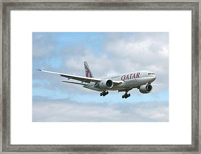 Qatar 777 Framed Print by Jeff Cook