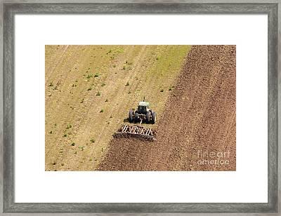 Quad Tractor Framed Print by John Ferrante
