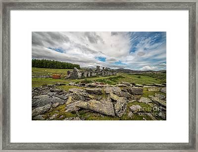 Quarry Cottages Framed Print by Adrian Evans