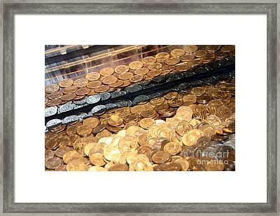 Quarters In An Arcade Game Framed Print