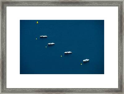 Quatre Petits Bateaux Framed Print by Kim Lessel