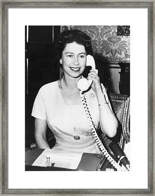 Queen Elizabeth On The Phone Framed Print