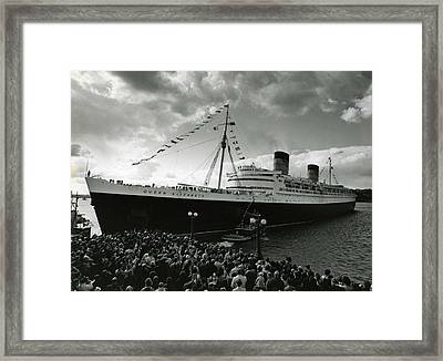 Queen Elizabeth Ship In Harbor By Barney Stein Framed Print by Retro Images Archive