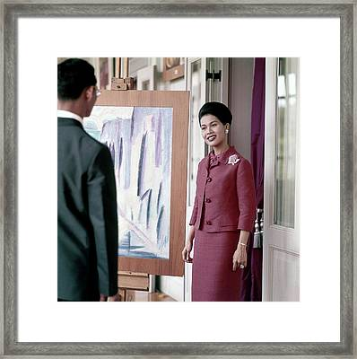 Queen Sirikit Of Thailand Looking At A Painting Framed Print
