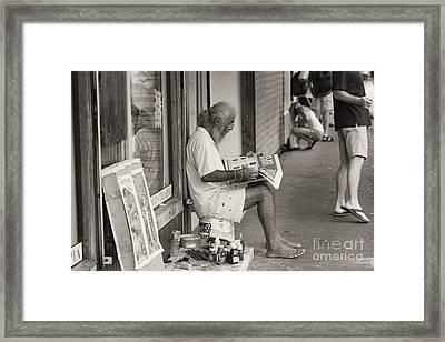 Quepos Street Artist Framed Print by Russell Christie