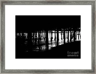 Quiet Pier Pillars Framed Print