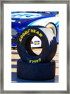Racing Rubber Framed Print by James Marvin Phelps