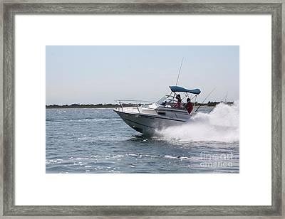 Racing Through The Ocean Framed Print by John Telfer