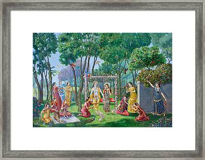 Radha Krishna On The Swing Framed Print by Dominique Amendola