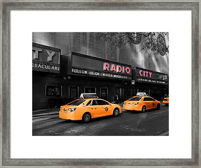 Radio City Music Hall And Taxis In New York City Framed Print