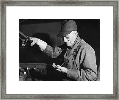 Railroad Engineer Checks Watch Framed Print by Underwood Archives