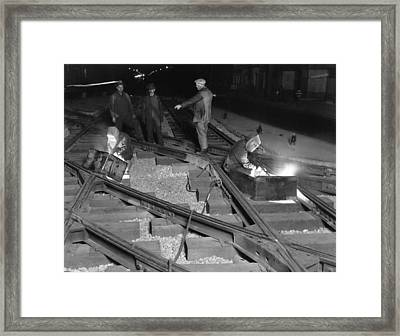 Railroad Workers Welding Track Framed Print by Underwood Archives