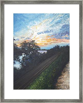 Rails Along The River Framed Print by Monica Veraguth