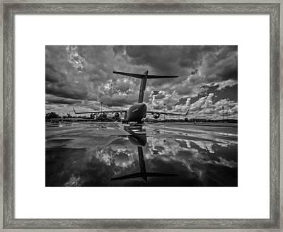 Rain At The Base Framed Print