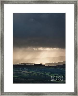Rain Clouds Over Dartmoor Framed Print by Jan Bickerton