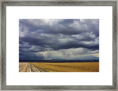 Rain In Wyoming Framed Print by Bruce Bley