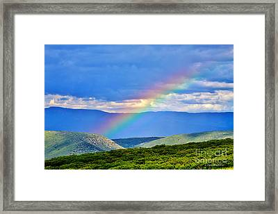 Rainbow Above The Canyon Framed Print by Janice Rae Pariza