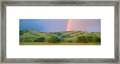 Rainbow And Rolling Hills In Central Framed Print by Panoramic Images