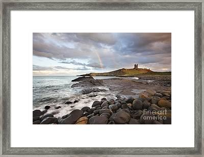 Rainbow At Dunstanburgh Castle Framed Print by Mark Sunderland