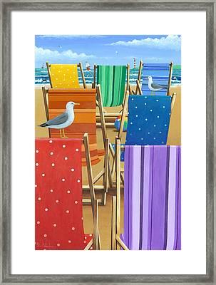 Rainbow Deckchairs Framed Print by Peter Adderley