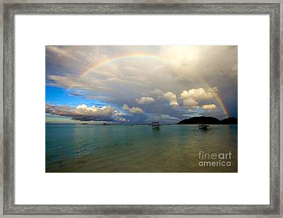Rainbow In The Seychelles Framed Print by Tim Holt