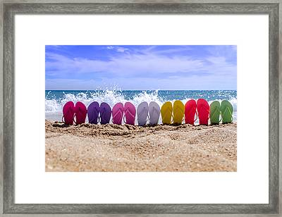 Rainbow Of Flip Flops On The Beach Framed Print