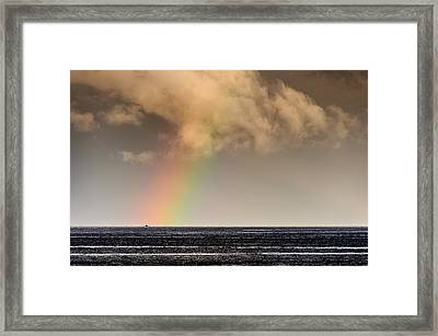 Rainbow Over A Black Ocean Framed Print by Colin Utz