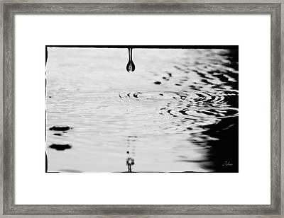 Raindrop And Circles. Framed Print by John Murphy