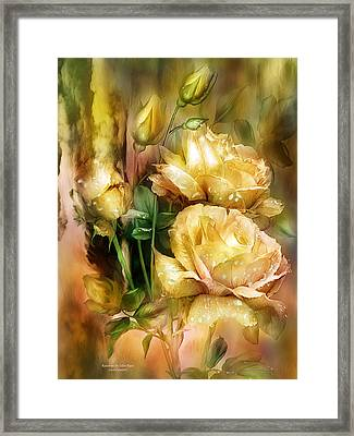 Raindrops On Yellow Roses Framed Print by Carol Cavalaris