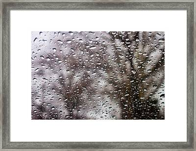 Raindrops Framed Print by Richie Stewart