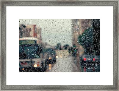 Rainy City Street Framed Print by Kim Fearheiley