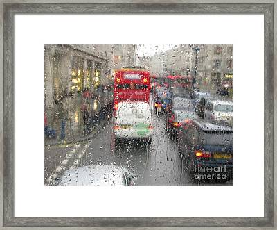Framed Print featuring the photograph Rainy Day London Traffic by Ann Horn