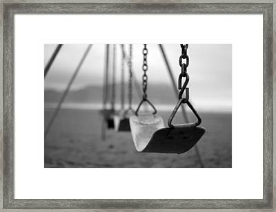 Rainy Day Swings Framed Print by Michael DeMello