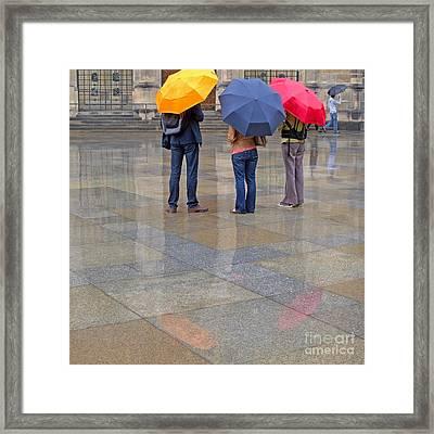 Rainy Day Tourists Framed Print by Ann Horn