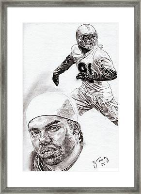 Randy Moss Framed Print by Jonathan Tooley