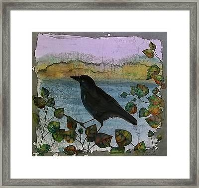 Raven In Colored Leaves Framed Print by Carolyn Doe