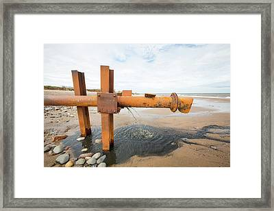 Raw Sewage Emptying Onto The Beach Framed Print by Ashley Cooper