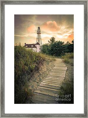 Rawley Point Lighthouse Under Smoldering Skies Framed Print