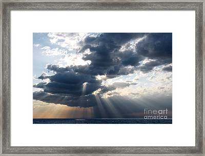 Rays And Clouds Framed Print
