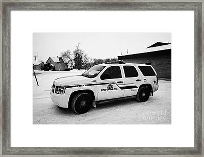 rcmp royal canadian mounted police 4x4 patrol vehicle outside station in the small town of Kamsack S Framed Print by Joe Fox