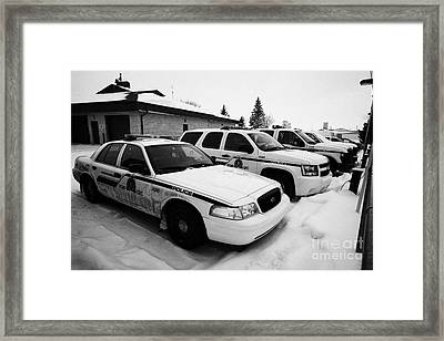 rcmp royal canadian mounted police vehicles outside station in the small town of Kamsack Saskatchewa Framed Print by Joe Fox