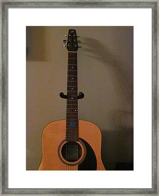 Reach For The Guitar Framed Print by Guy Ricketts
