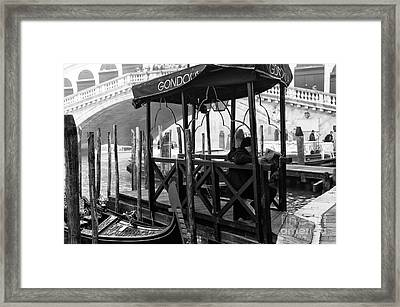 Reading The Paper In Venice Framed Print by John Rizzuto