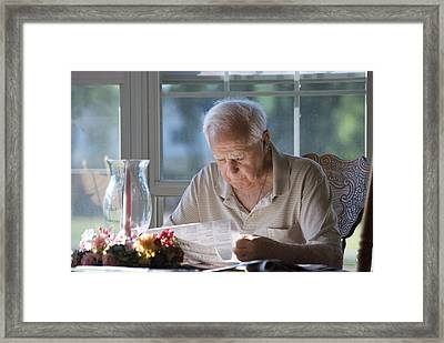 Reading The Sunday News Paper Framed Print