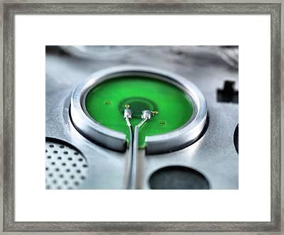 Rear Of A Power Button Framed Print