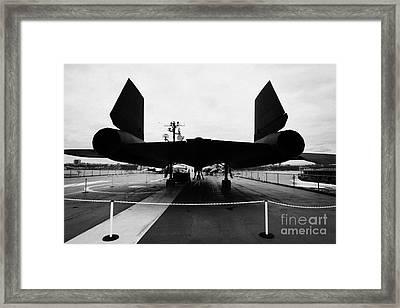 rear of Lockheed A12 Blackbird on display on the flight deck at the Intrepid Sea Air Space Museum Framed Print by Joe Fox