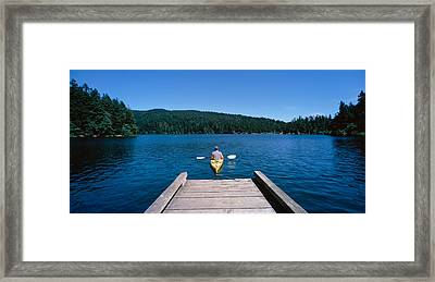 Rear View Of A Man On A Kayak Framed Print