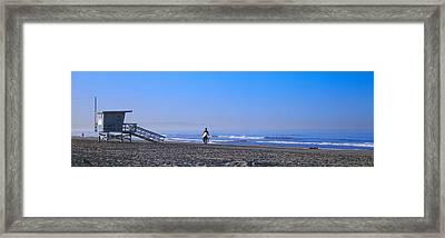Rear View Of A Surfer On The Beach Framed Print