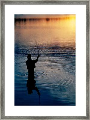Rear View Of Fly-fisherman Silhouetted Framed Print by Panoramic Images